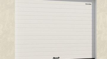 Гаражные секционные ворота из алюминиевых панелей с пружинами растяжения